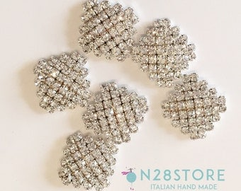 Elegant button strass. Ideal for dresses, fashion accessories and handcrafts.