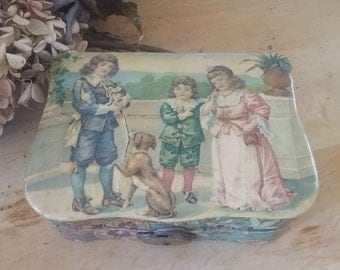 Antique celluloid dresser jewelry box with children and a dog and cat