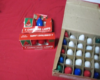 Vintage Christmas light bulbs 35 in all, variety of colors fix the lights with these bulbs. Replacement bulbs.