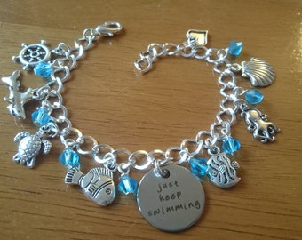 Just keep swimming deluxe silver adjustable charm bracelet available in adult and child sizes