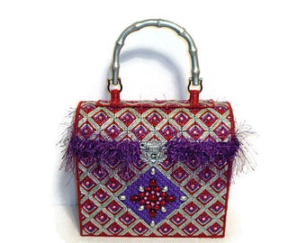 Purple red and silver trunk bag