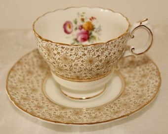 Cauldon: Footed tea cup and saucer, with beautiful bouquet of flowers