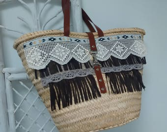 Hand-decorated with lace and suede fringe carrycot