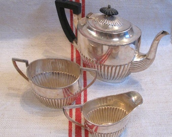 Walker and Hall Silver Plated 3 Piece Tea service, teapot, sugar bowl, creamer