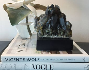 Dramatic dark smoky quartz points mounted on a  custom-made concrete sculpture stand-Smoky Quartz is Known To Help Remove Negativity