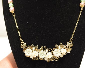 Antique look gold necklace with pastel flowers and beads