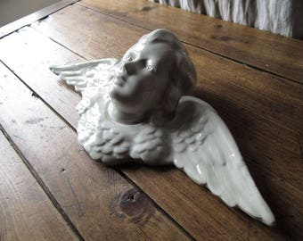 Old antique earthenware putti angel
