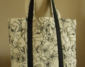 Beige embroidered black tote bag