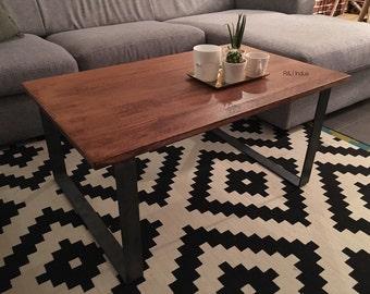 Coffee table in oak and raw flat steel legs