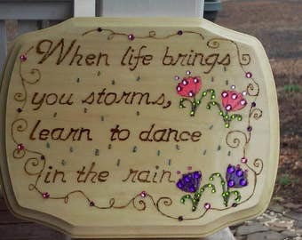 """Wood burned plaque with inspirational saying """"When life brings you storms..."""" painted and embellished with crystals"""