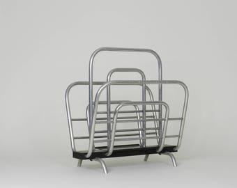 Art Deco magazine rack in tubular aluminum and painted wood.  Canada, 1930s.