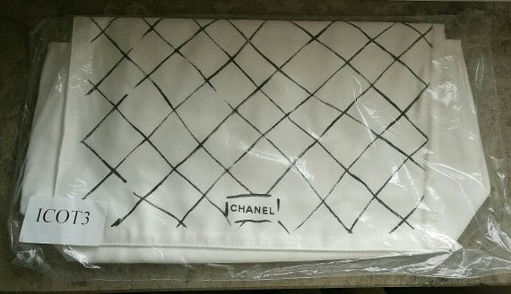 Size L Chanel white tone dust bag, bag protection designed and signed by Mr. Karl Lagerfeld