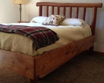 Custom made live edge spalted Alder Queen bed.