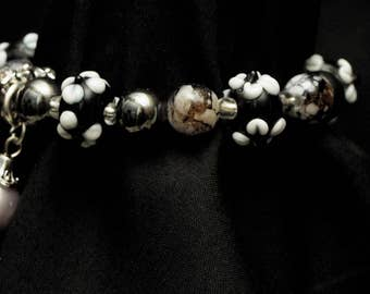 Black and White Beaded Bracelet with Charm