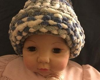 Newborn knitted baby hat.