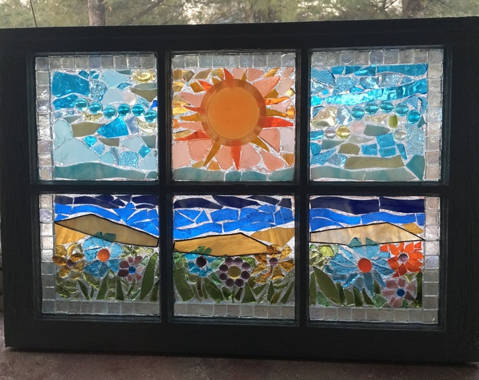 Old distressed window with various recyclable glass pieces