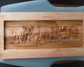 SCERNERY-WOOD CARVINGS--moose on the plains