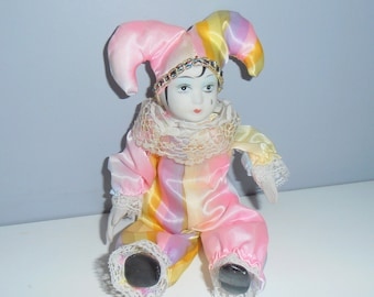 Vintage old Porcelain collectible clown pierrot french Harlequin jester circus art doll handpainted face colorful rainbow colors costume