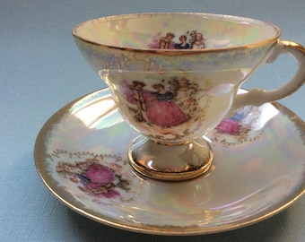 RESERVED FOR H  Vintage footed tea cup and saucer with Fragonard's courting couple, lusterware tea set, Royal porzellan