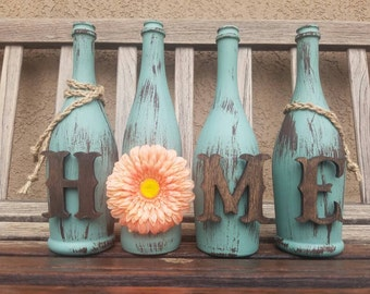 Decorated wine bottles. Home decor. Painted wine bottles. Mantel decor. Table decor. Rustic decor. Wine bottles. Wine decor. Bar decor.