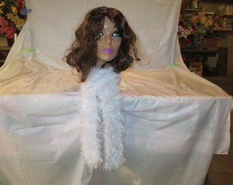 A white fuzzy crochet scarf