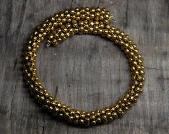 gold metal heishi bracelet