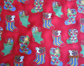 Red fabric with Christmas Stocking print