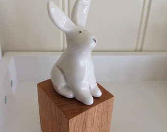 Porcelain rabbit on oak base