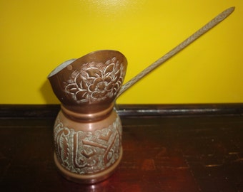 Arabic Coffee pot with extended handle  looks like in copper