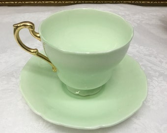 1930's Double Warranted Paragon mint green teacup and saucer.