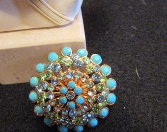 Aurora borealis rhinestone and faux turquoise cluster brooch in gold tone statement brooch which will catch everyone's eye!