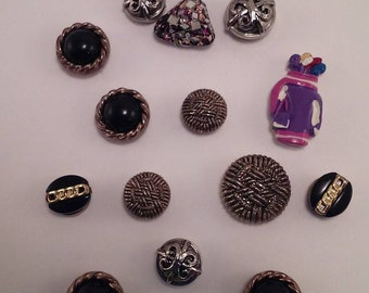 A Lot of 18 button covers made up of  7 different styles.