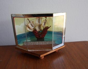 Retro kitsch shell art ship/boat in glass and timber case