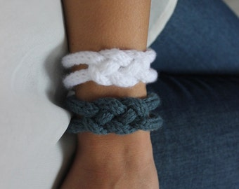 Pair of knitting, wool jewelry bracelet