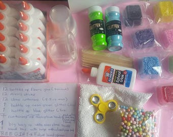 DIY Slime kit for slime sellers or for kids parties. Contains glue, glitter, containers, foam balls. Free fidget spinner with purchase