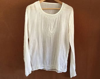 The barely there sheer white vintage hippie girl embroidered top