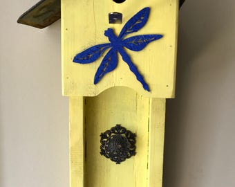 Bright yellow reclaimed solid wood birdhouse with cobsly nlue dragon fly, antique knob ans licence plate roof