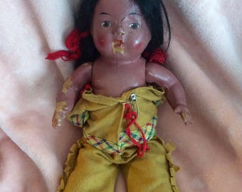 Vintage composition Native American doll