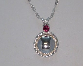 handmade sterling silver and garnet pendant on a sterling silver chain