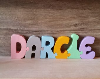 First name Darcie puzzle wooden letters.