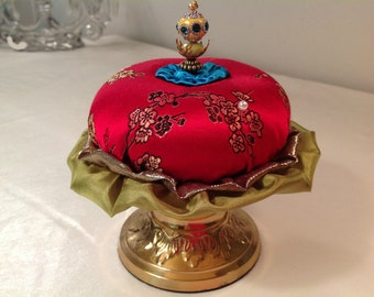 "Pincushion. Red with Flowers on Brass Stand, 6"" by 5.5"",  9 oz net, #0325"