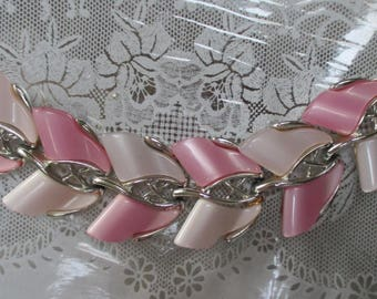 "A vtg. pink and white thermoset bracelet with silvertone finish--6-1/2"" x 1-1/2"" wide--from the 70s"