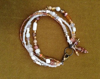 White and golds, beaded 4 strand women's bracelet, charms, artisan, one of a kind