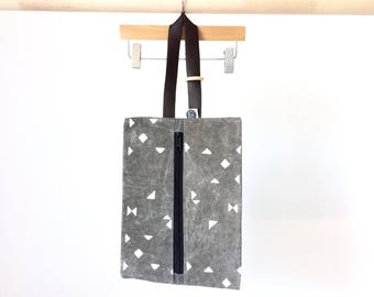 Grey waxed canvas nappy bag made with organic cotton dyed naturally , leather handle with teething ring