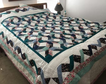 Very nice machine sewn, hand quilted 84x84 queen quilt.