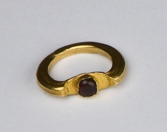A Gold and Garnet Ring. Java 9 - 12th Century