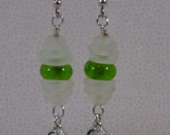 Apple green and clear matte swirl capped glass bead dangle earrings