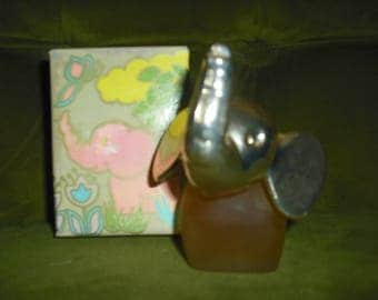 This Avon Decanter is the Royal Elephant and has a glass ody with a Siver head.