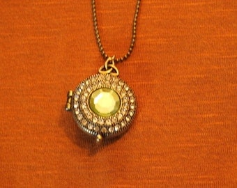 vintage like locket necklace with light green august peridot looking birthstone