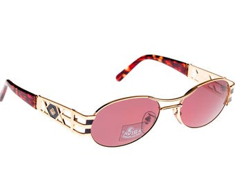 Von Furstenberg vintage sunglasses 80s, made in Italy. Gold metal oval sunglasses with double bar on top, unisex